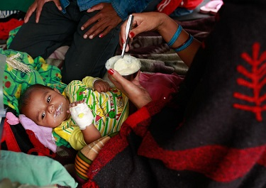 On 26 April, a woman feeds her infant, who was injured during the massive earthquake, at Tribhuvan University Teaching Hospital in Kathmandu, the capital.